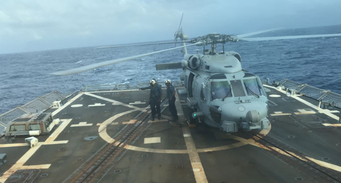 Republic of Fijian Navy Maritime Commander, Commander Ledua Yaco and Ordinary Seaman Samuela Basaga arrive on board the USS Shoup (DDG 86).