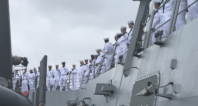 Part of the 320-member crew on board the USS Shoup (DDG 86) .
