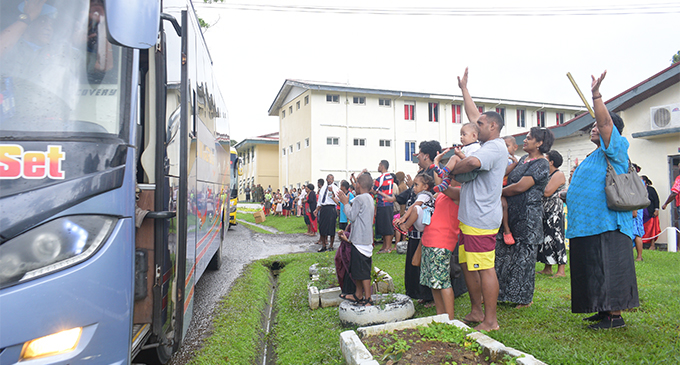 Family and friends farewell and waving to RFMF officers on board the bus to Nadi.