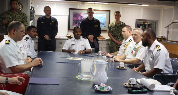 USS Shoup (DDG 86) commanding officer Commander Andy Strickland (first from left) with his officers during a meeting with (first from right) Republic of the Fiji Military Forces Navy fleet operations officer Lieutenant Commander Timoci Natuva (Junior) and his team on board the USS Shoup (DDG 86) on October 14, 2018. Photo: Wati Talebula