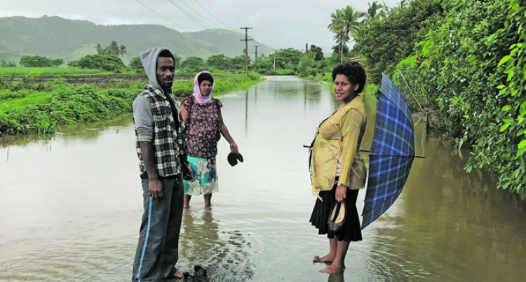 Mother-to-be Struggles to Walk Home in 4km Flooded Roads