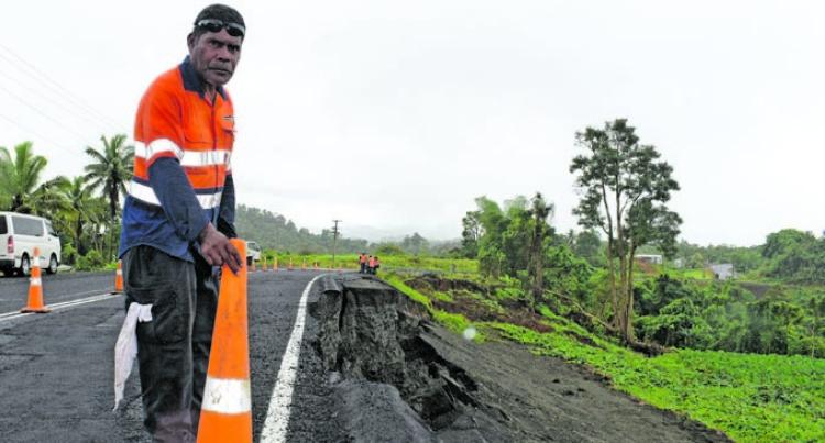 Road Slip Hampers Villagers' Travel