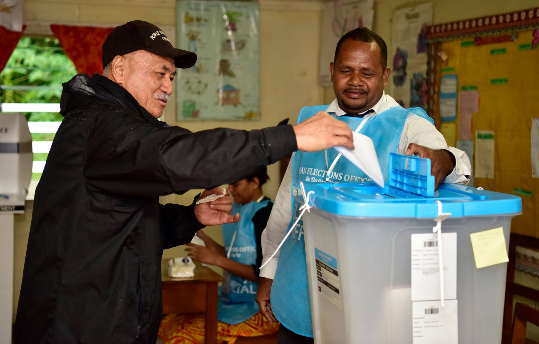 President Major-General (Ret'd) Jioji Konrote on November 14, 2018, braved the heavy rain in Suva and walked to Draiba Primary School to cast  his ballot.  Department of  Information Photographer