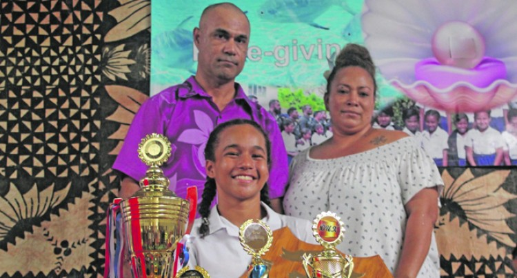Charlize-Joy Balances School, Swimming and Dad's There Too
