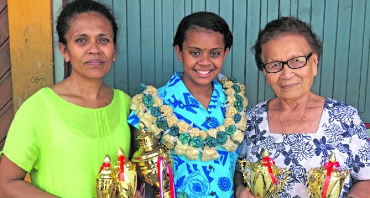 Aspiring Doctor Johnelle Makes Family Proud