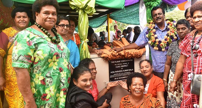 Market vendors are all smiles after the unveiling of the plaque for Cuvu Municipal Market by Minister for Local Government Parveen Bala (with garland).  Photo: Deptfo News