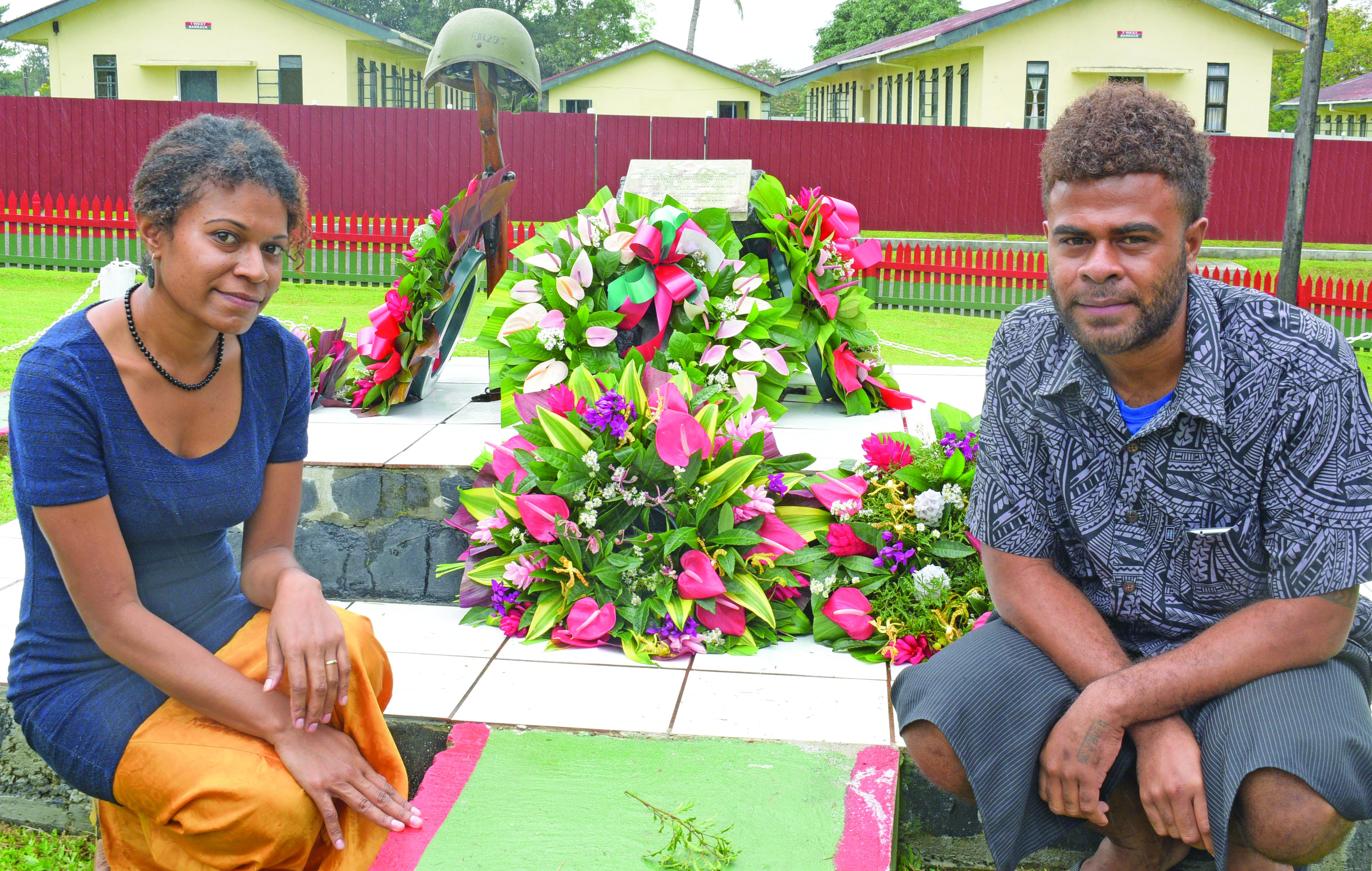 Ro Liku Vosailagi with her brother, Apisai Bogitini at the memorial site for their late father, Private Osea Rokosirinavosa, who was killed during the November 2000 mutiny at Queen Elizabeth Barracks in Nabua. Photo: Ronald Kumar