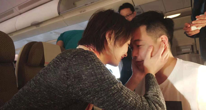 Love is in the air, Peng Wu and Yvonne Lai onboard the Fiji Airways flight from Hong Kong to Nadi. Photo: Shratika Prasad.