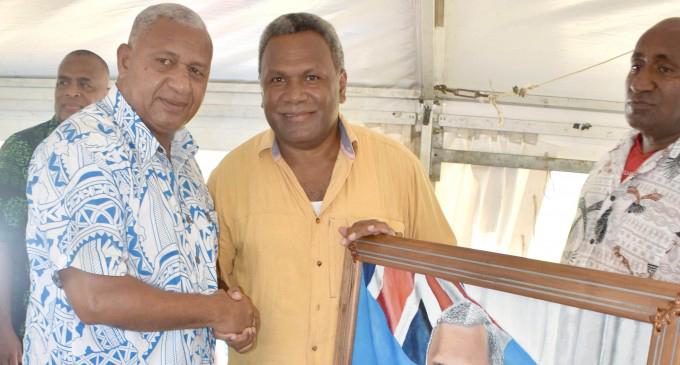 Prime Minister Voreqe Bainimarama with Maciu Navakasuasua.