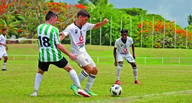 Baber's Son Takes Football