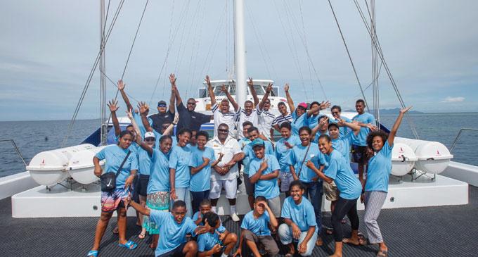Children and Cure Kids Fiji team aboard Fiji One, Captain Cook Cruises.
