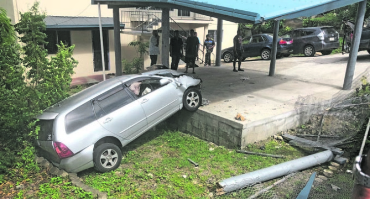 Family Unhurt As Taxi Crashes Into Garage