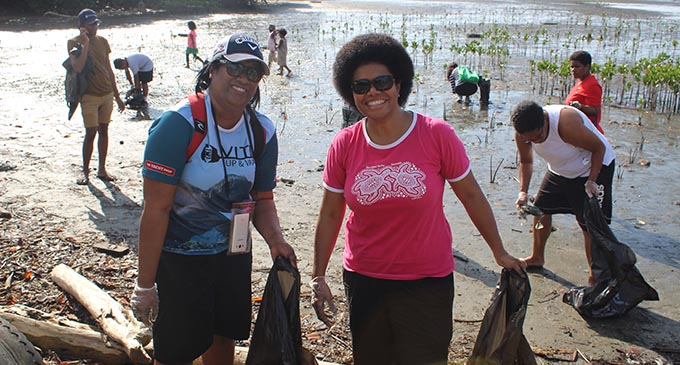 Member of Parliament Lenora Qerqeretabua with volunteers during the beach clean up