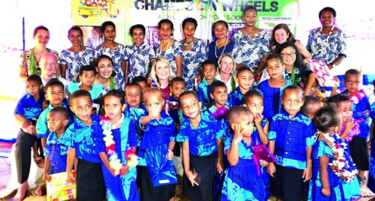 IMF Donates More Than $15k To Champs On Wheels
