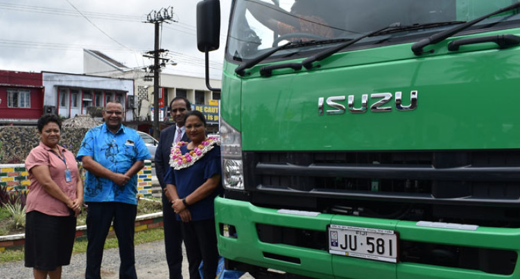 Minister Premila Kumar Hands Over New Compactor Truck