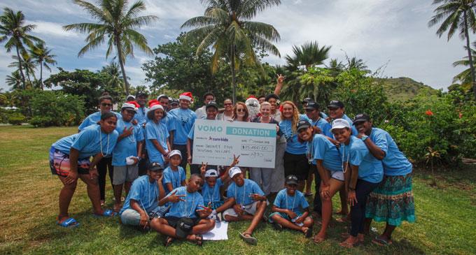 Renee Leslie, brand ambassador of Vomo Island Fiji presents $25,000 to Cure Kids Fiji.