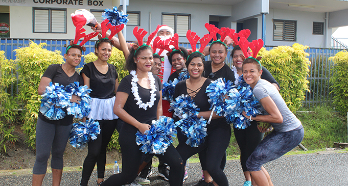 Santa Claus Petero Civoniceva with cheerleaders after the 5 kilometre diabetes dash in Suva on December 15, 2018. Photo: Simione Haravanua