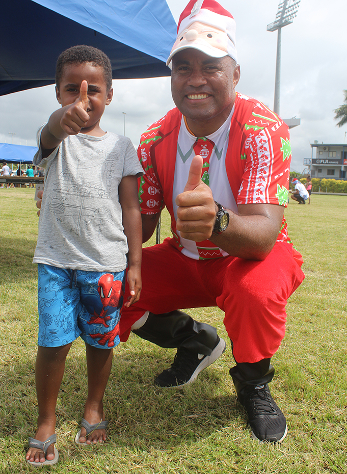 Rugby league legend and organizer Petero Civoniceva with young Rayden Nelson during the 5km diabetes dash on December 15,2018.Photo:Simione Haravanua.