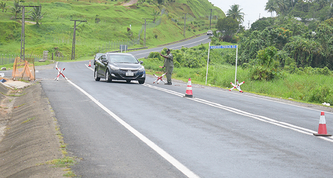 An officer of the Fiji Corrections Service monitors checkpoint on December 24, 2018, along Queens Road to track down the remaining prison escapees. Photo: Simione Haravanua