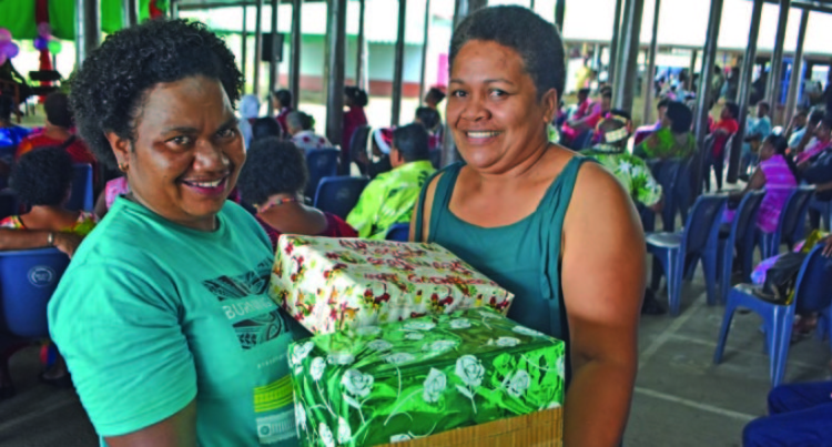 Vendors Share The Joy Of Christmas, Exchange Gifts