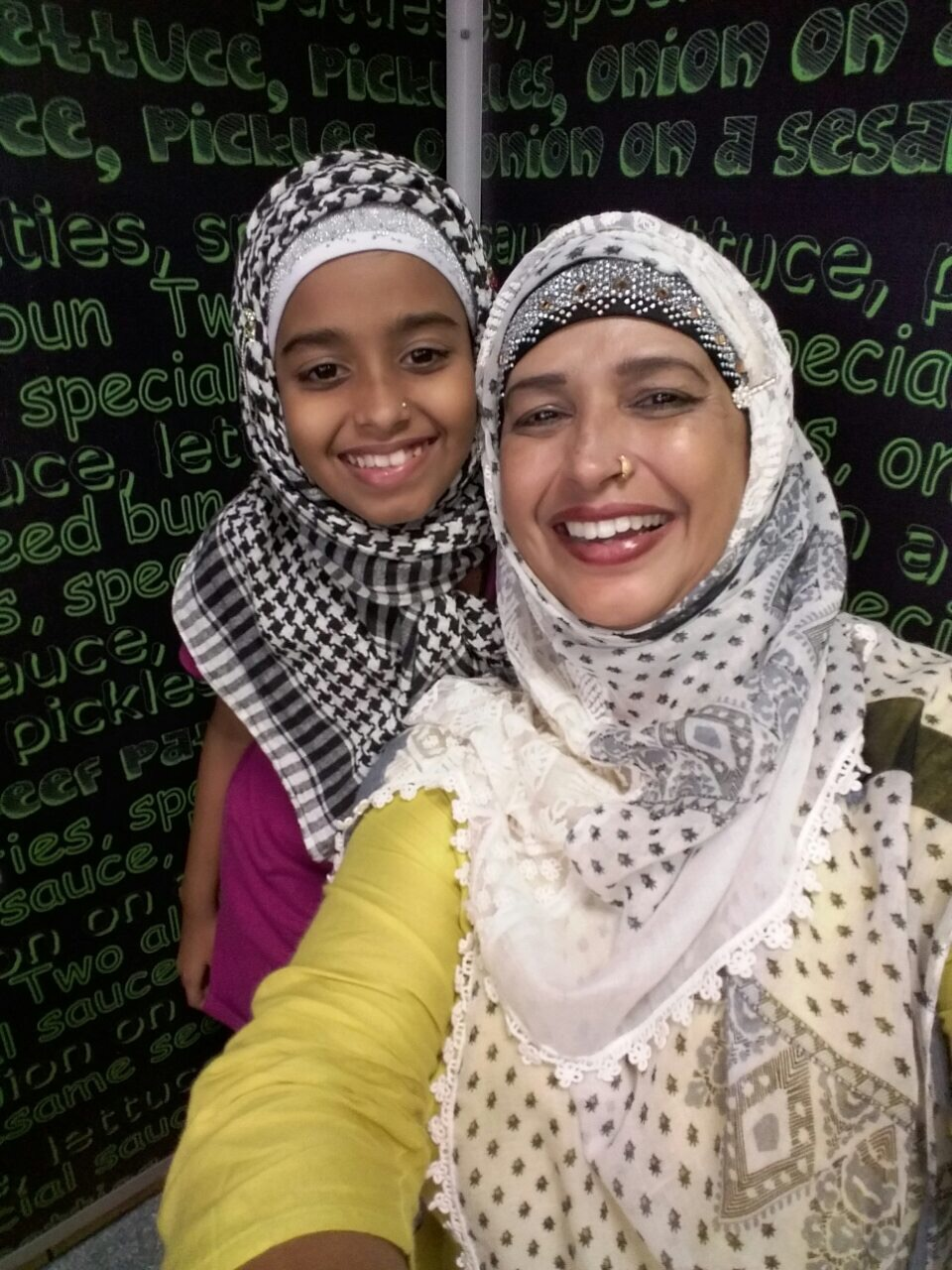 Young Ameera Azraa Abdul with her mother Um Hadiba.