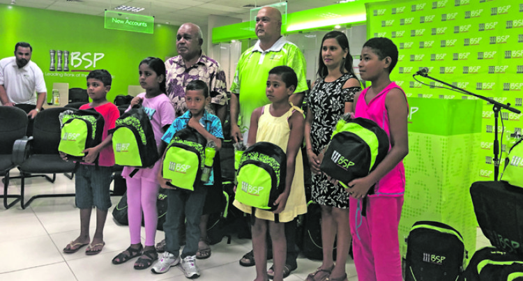 Bank Helps Needy Children With School Packs BSP, FENC