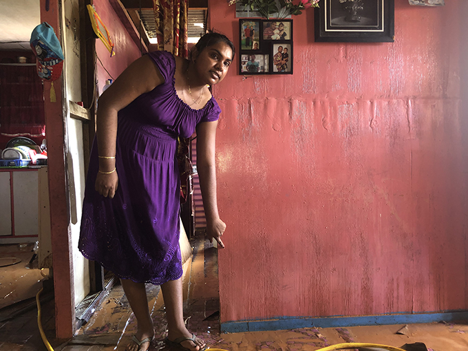 Somal Radhika Chand indicates the water level of the flooding at Waidamudamu Settlement in Koronivia on January 21, 2019. Photo: Sheenam Chandra