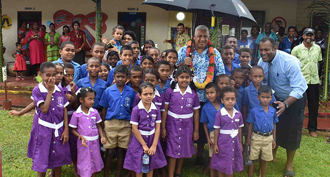 Prime Minister Voreqe Bainimarama with students, teachers and officials during the commissioning of the Namau Grid Extension project in Ba on January 29, 2019. Photo: Waisea Nasokia