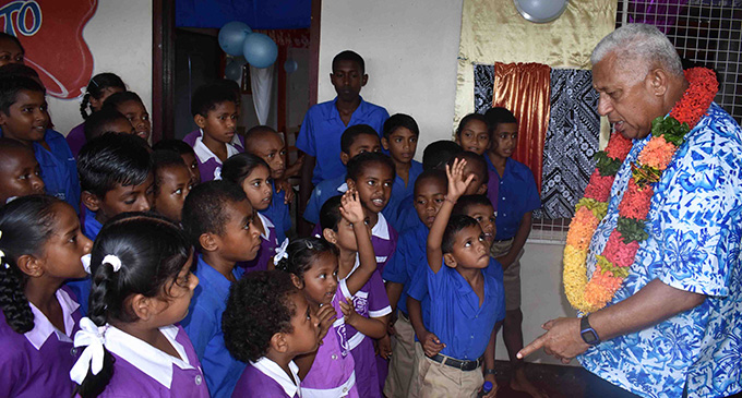 Prime Minister Voreqe Bainimarama is assisted by students of Namau Public School in Ba during the commissioning of the Namau Grid Extension on January 29, 2019. Photo: Waisea Nasokia