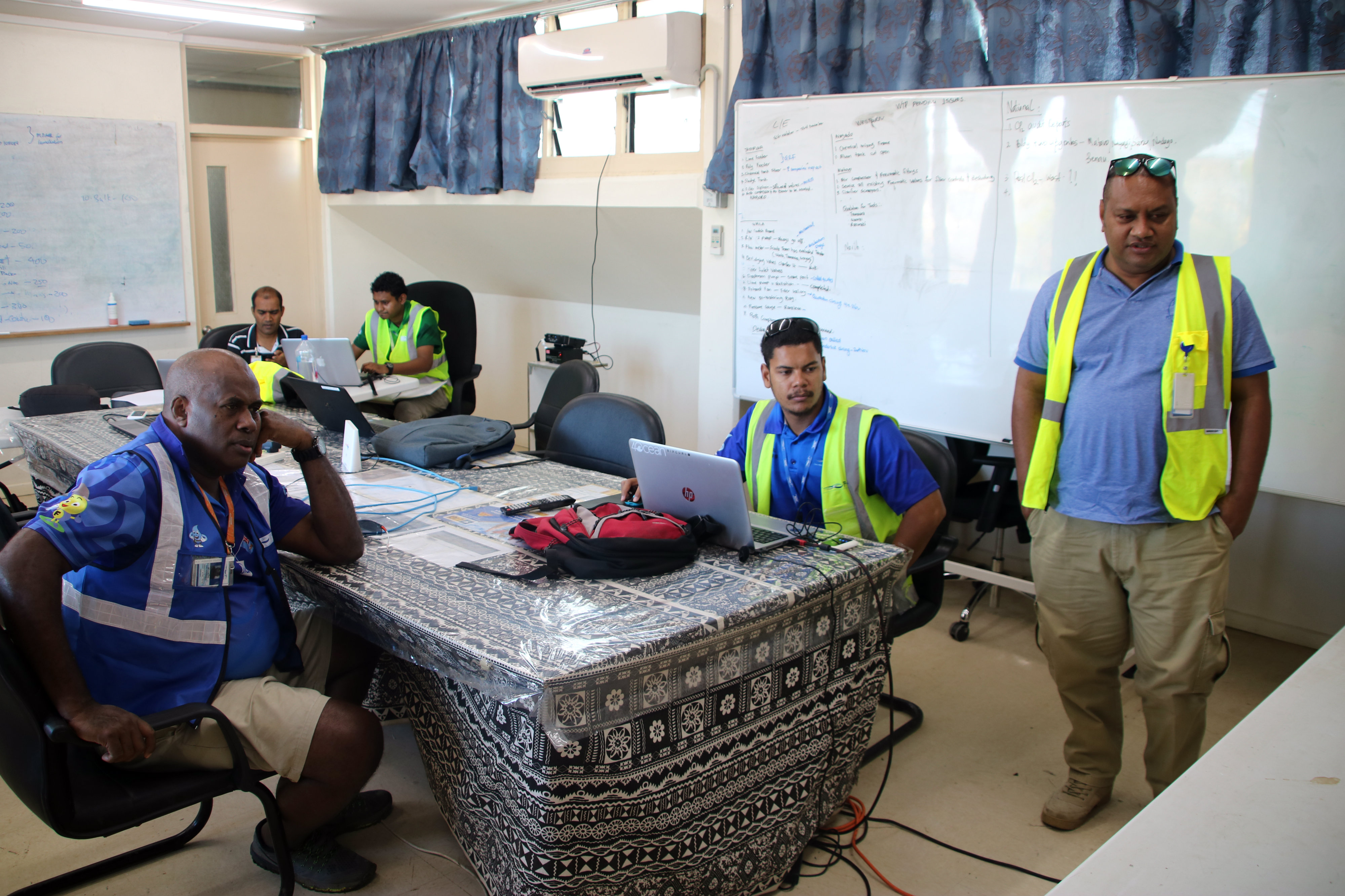 Water Authority of Fiji (WAF) general manager customer services and acting general manager operations Sekove Uluinayau (standing right), team leader SCADA Thomas Hughes and regional manager central eastern, Ilisoni Saladuadua, during a briefing at the Waila Water Shutdown Control Centre at the Waila Water Treatment Plant on January 13, 2019. Photo: WAF