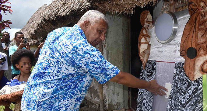 Prime Minister Voreqe Bainimarama ready to switch the light on during the Navala Grid Extension project in Ba on January 29, 2019. Photo: Waisea Nasokia