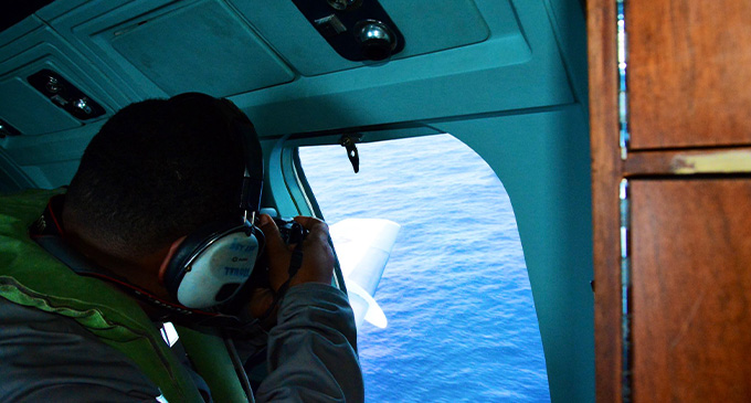 Aerial surveillance with a Fiji Navy official.