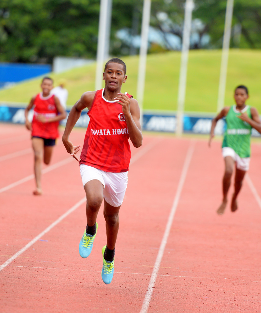Donald Mailoto (middle) of Tovata House won the 200meters junior-boys heats during Queens Victoria School inter-house at ANZ Stadium on February 15, 2019. Photo: Ronald Kumar.