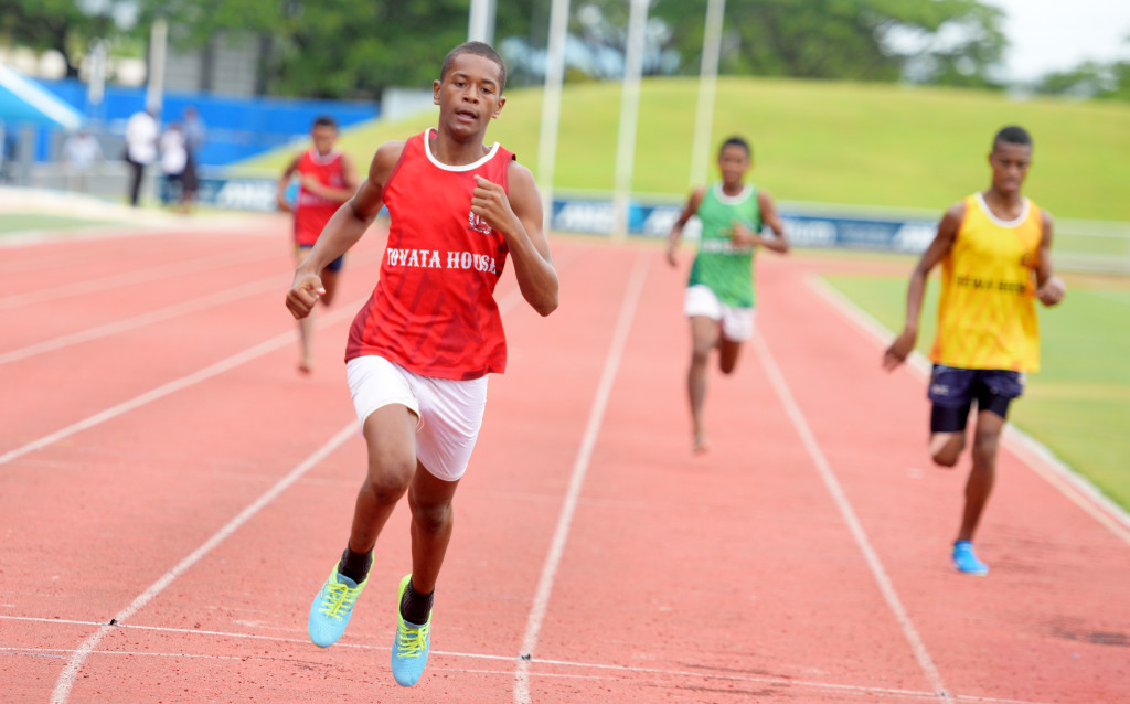 Donald Mailoto (left) of Tovata House won the 200meters junior-boys heats during Queens Victoria School inter-house at ANZ Stadium on February 15, 2019. Photo: Ronald Kumar.
