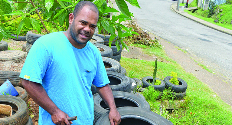 Man Uses Tyres In Garden And Fencing
