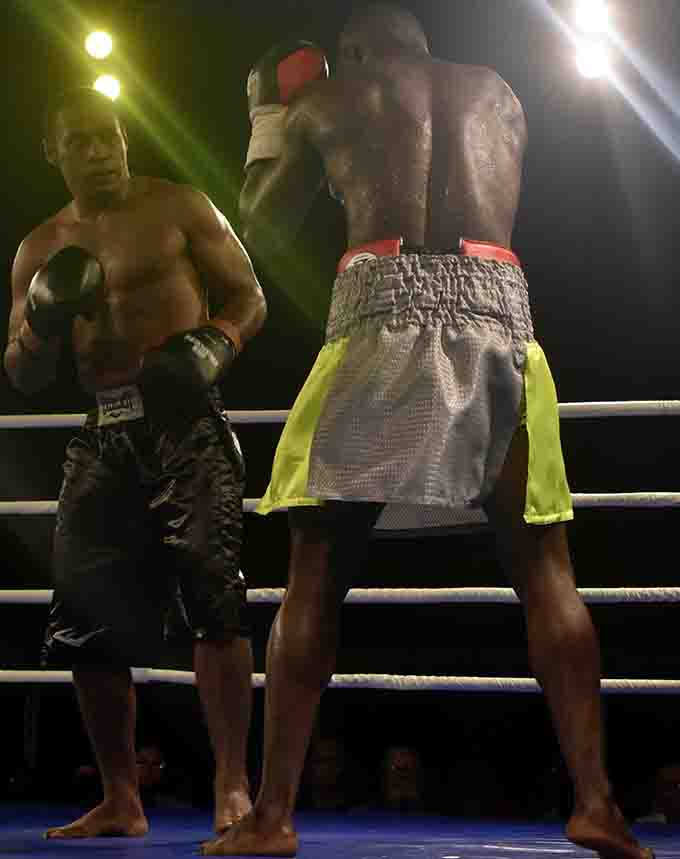 Ba's Savenaca Naliva and Joseph Kwadjo in bare foot in the main bout at Prince Charles Park in Nadi on Saturday night. Photo: WAISEA NASOKIA