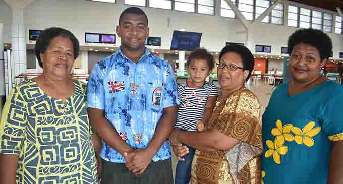Ravunivadra Uluilakeba with his family at the Nadi International Airport yesterday. Photo: WAISEA NASOKIA