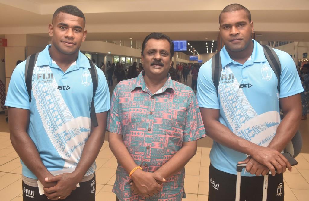 Fiji Airways 7s rep Apenisa Cakaubalavu, Minister for Youth and Sports Praveen Bala and Josua Vakurinabili at the Nadi International Airport yesterday. Photo: WAISEA NASOKIA