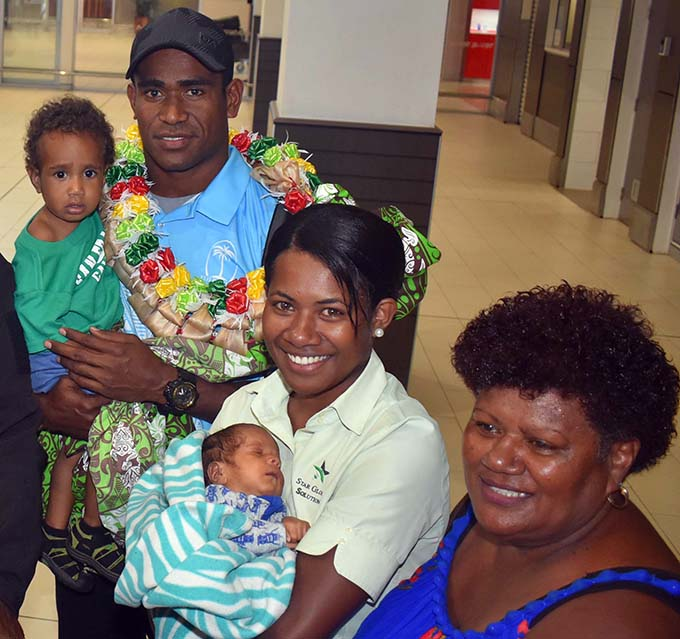 Fiji Airways 7s rep Aminiasi Tuimaba with family members at Nadi  International Airport on March 13, 2019. Photo: Waisea Nasokia