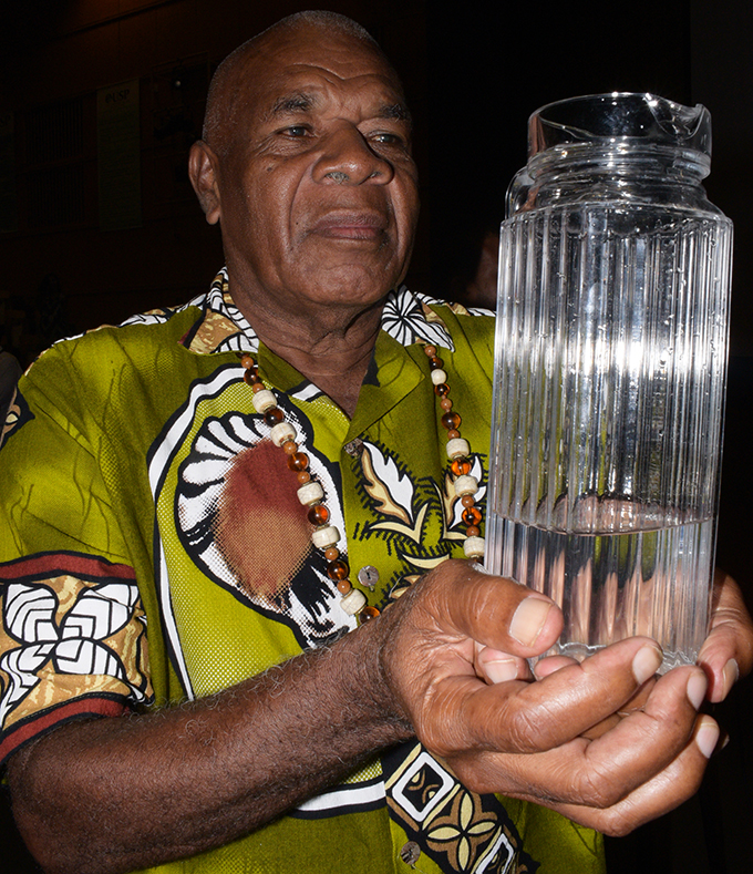 Eroni Koroiwaca, headman of Nakini Village, Naitasiri, shows clean drinking water from the village during the opening of the Ecological Purification System (EPS) Public Seminar at University of South Pacific on March 12, 2019. Photo: Ronald Kumar