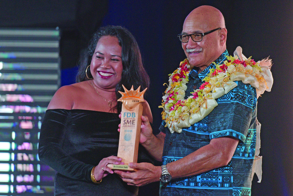 Maria Ronna Luna of the The Green Stadio receive her Women Entrepreneur of the year award from President Jioji Konrote during FDB National SME awards at Grand Pacific Hotel on February 28, 2019. Photo: Ronald Kumar.