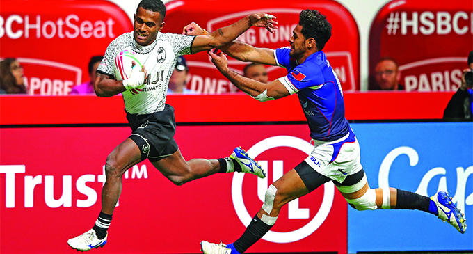 Fiji Airways Fijian Sevens player Terio Tamani fends off a Samoa player in their final pool match of the Canada Sevens in Vancouver on March 10, 2019. Photo: World Rugby