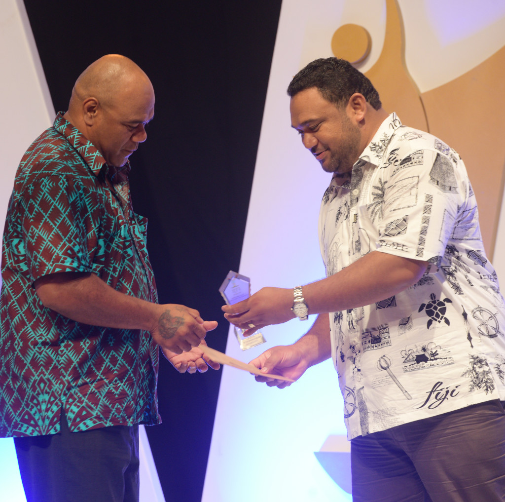 Senirusi Seruvakula (left) received Coach of the year award from Jeffrey Smith during 2018 Fiji Sports Awards at FMF Gymnasium on March 01, 2019. Photo: Ronald Kumar.
