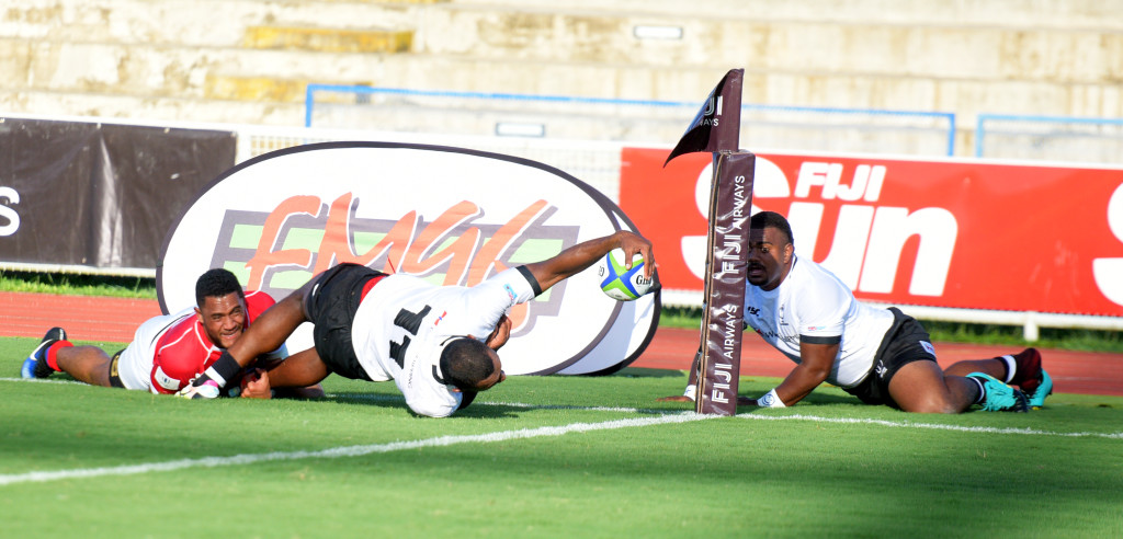 Fiji Warriors Tira Patterson reached out for try line as Mesulame Dolokoto looks on against Tonga during 2019 World Rugby Pacific Challenge at ANZ Stadium on March 8, 2019. Photo: Ronald Kumar.