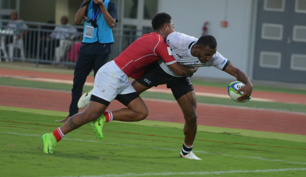 Tonga A's Weir Filikitonga fail to stop Fijian Warriors Tira Patterson's try during 2019 World Rugby Pacific Challenge at ANZ Stadium on March 8, 2019. Photo: Ronald Kumar.