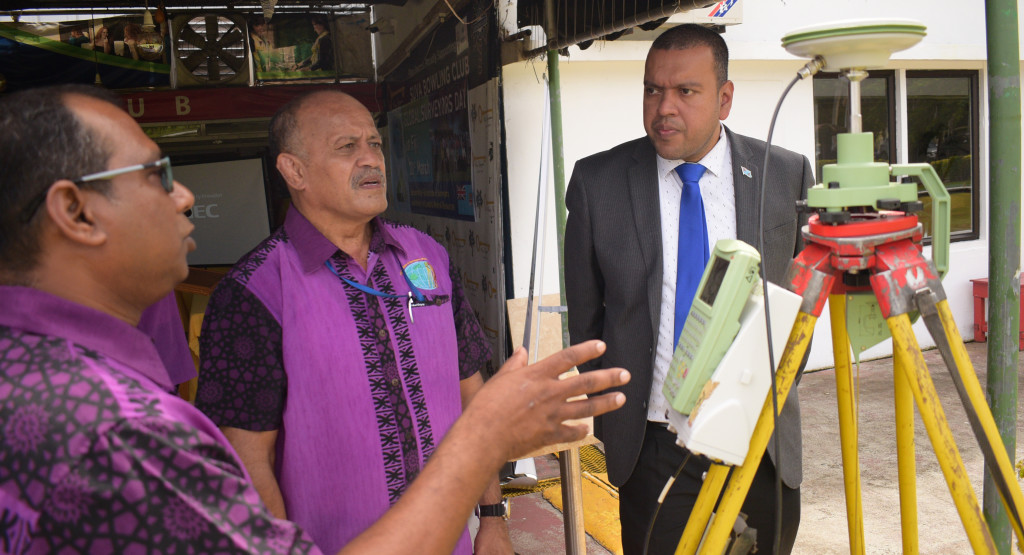 Andrick Lal (left) and Fiji Institute of Surveyors Council President Paserio Samisoni explain the GNSS survey equipment to Minister for Lands Ashneel Sudhakar during Global Surveyors Day on March 21, 2019. Photo: Ronald Kumar.