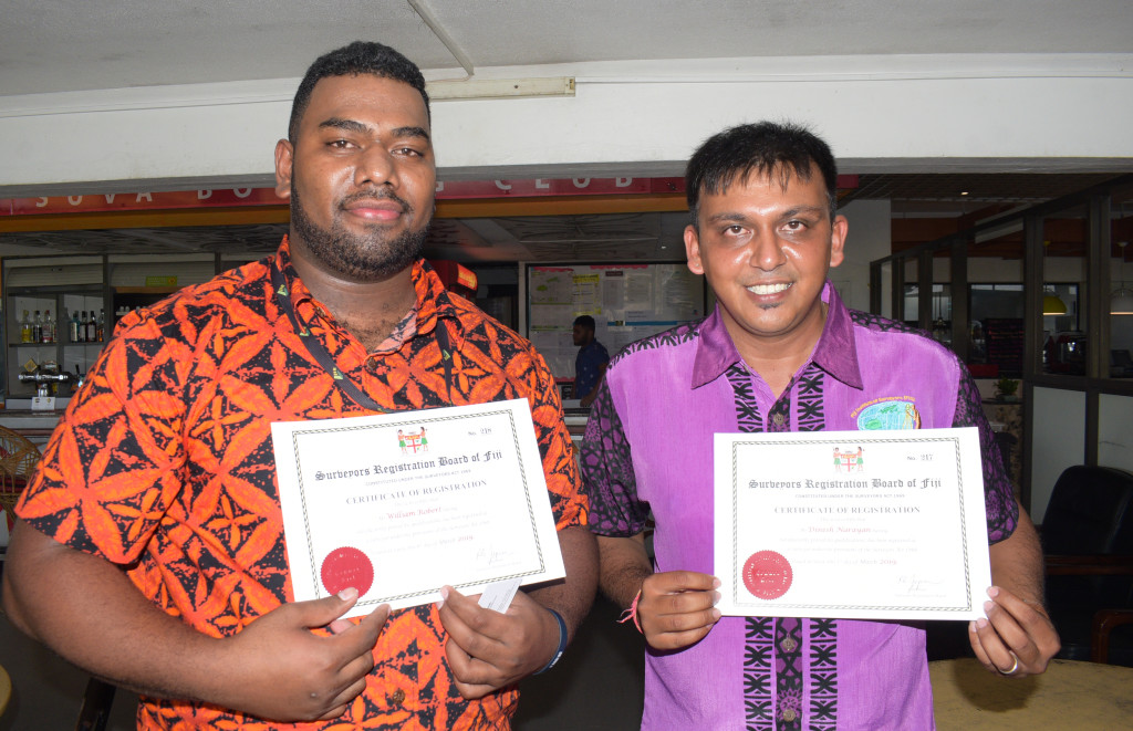 William Robert (left) and Dinesh Narayan with their registration certificate as surveyors during Global Surveyors Day on March 21, 2019. Photo: Ronald Kumar.