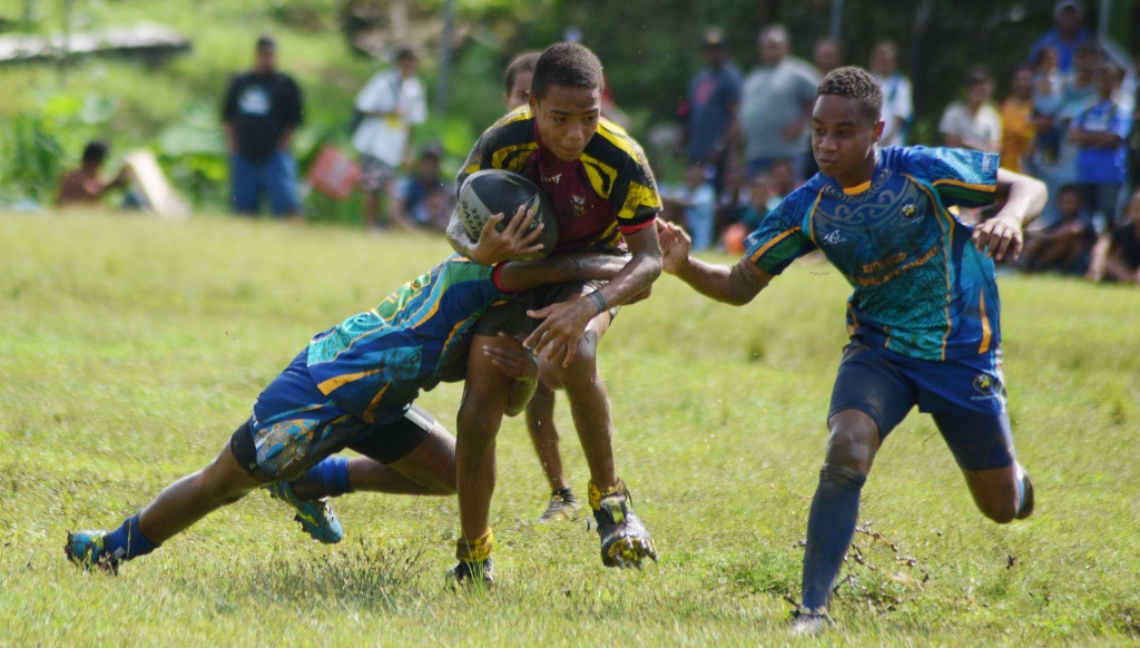 Ram Sami Nasinu kaji rugby under 13 action between Nabua Primary and Christian Mission Fellowship primary at AOG ground in Kinoya on March 30, 2019. Photo: Ronald Kumar.