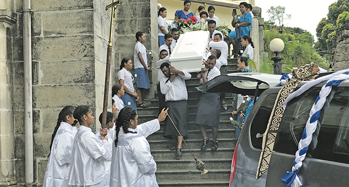 Pall bearers carry the casket of Sister Genevieve Loo at Sacred Heart Cathedral in Suva on March 4, 2019. Photo: Ashna Kumar
