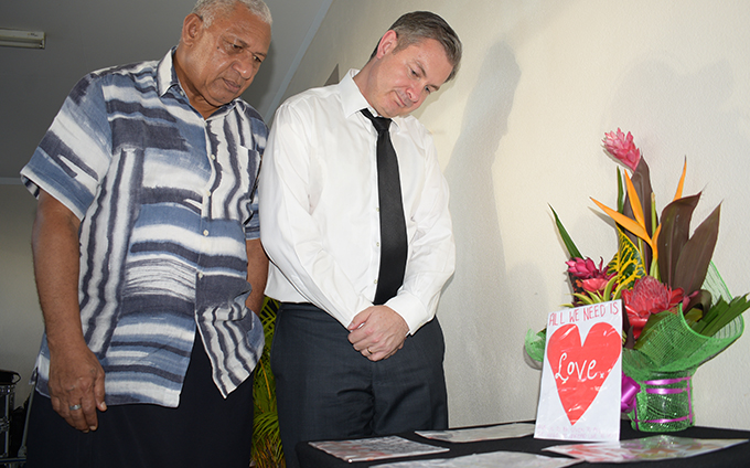 Prime Minister Voreqe Bainimarama with New Zealand High Commissioner to Fiji Jonathan Curr reading condolence messages from Fijians to the people of Christchurch, NZ, after the opening prayer at Makoi Women's Vocational Centre on March 17, 2019.  Photo: Simione Haravanua
